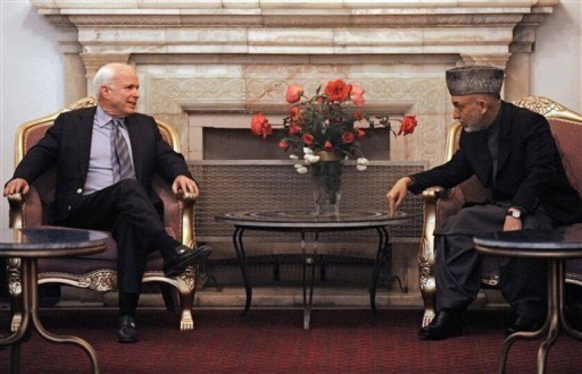 Afghan President Hamid Karzai, right, speaks with U.S. Sen. John McCain, left, at the presidential palace, Kabul, Wednesday, Nov. 10, 2010. (AP Photo/Massoud Hossaini, Pool)