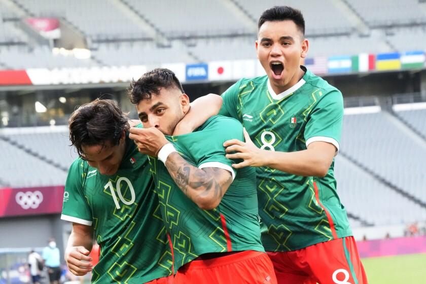Mexico's Alexis Vega, center, celebrates his goal with teammates Carlos Rodriguez