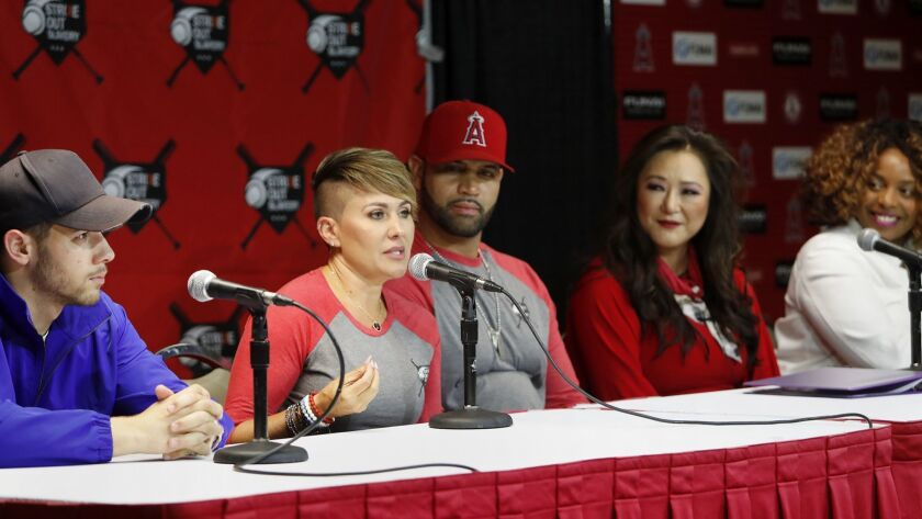 Deidre Pujols, second from left, speaks during a press conference for Strike Out Slavery at Angel St