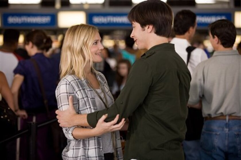"""In this film publicity image released by Warner Bros., Drew Barrymore, left, and Justin Long are shown in a scene from """"Going the Distance."""" (AP Photo/Warner Bros., Jessica Miglio)"""
