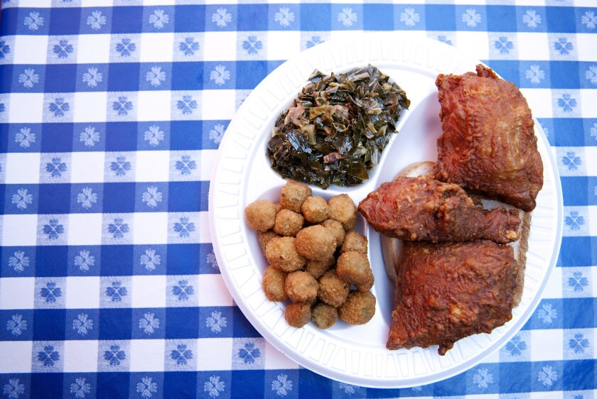 Fried okra, greens and fried chicken at Gus's World Famous Fried Chicken