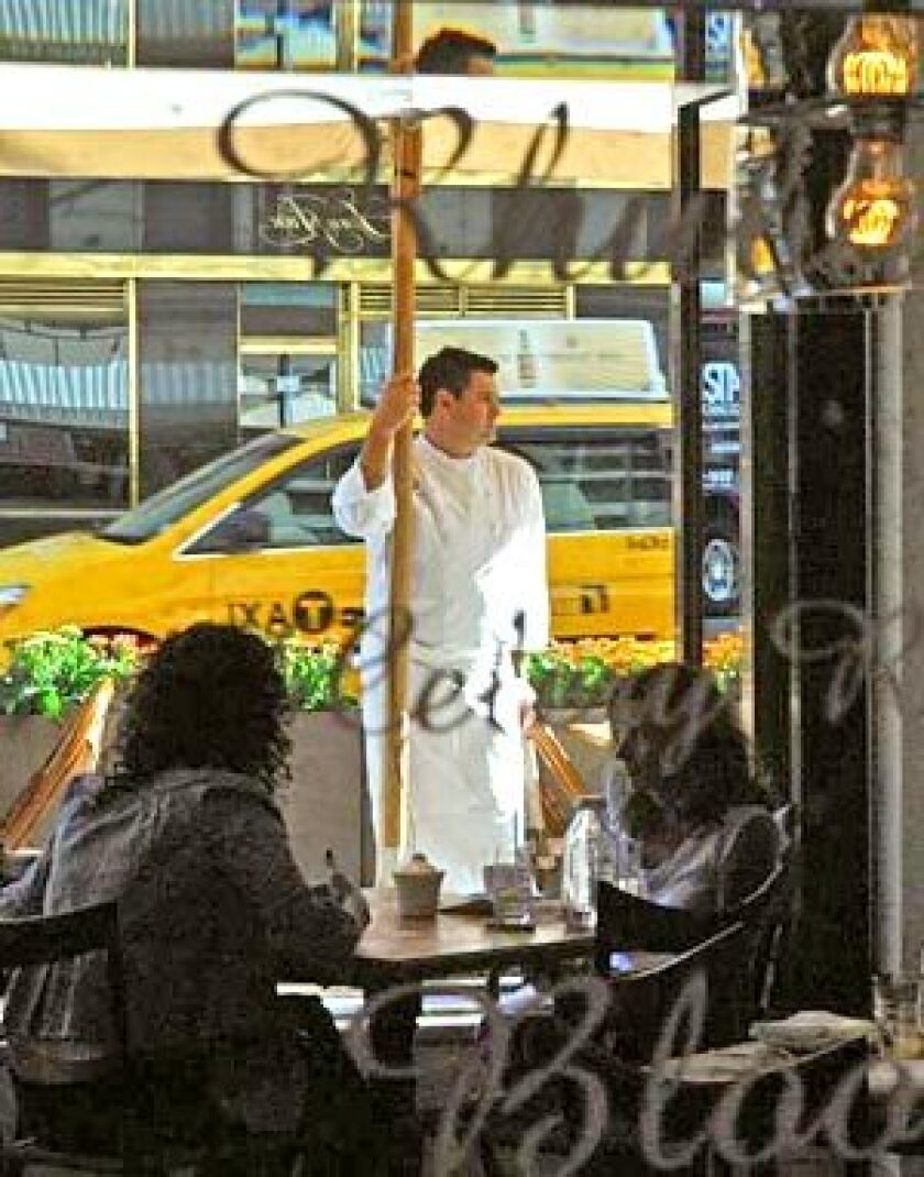 Laurent Tourondel stands outside his new restaurant in New York, BLT Market. BLT Steak will open this winter in the old Le Dome space.