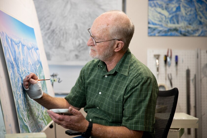 James Niehues works on a map at his home studio in Parker, Colo.