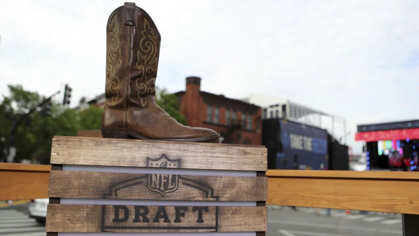 The logo for the 2019 NFL Draft is seen with a cowboy boot in Nashville on Tuesday, April 23, 2019.