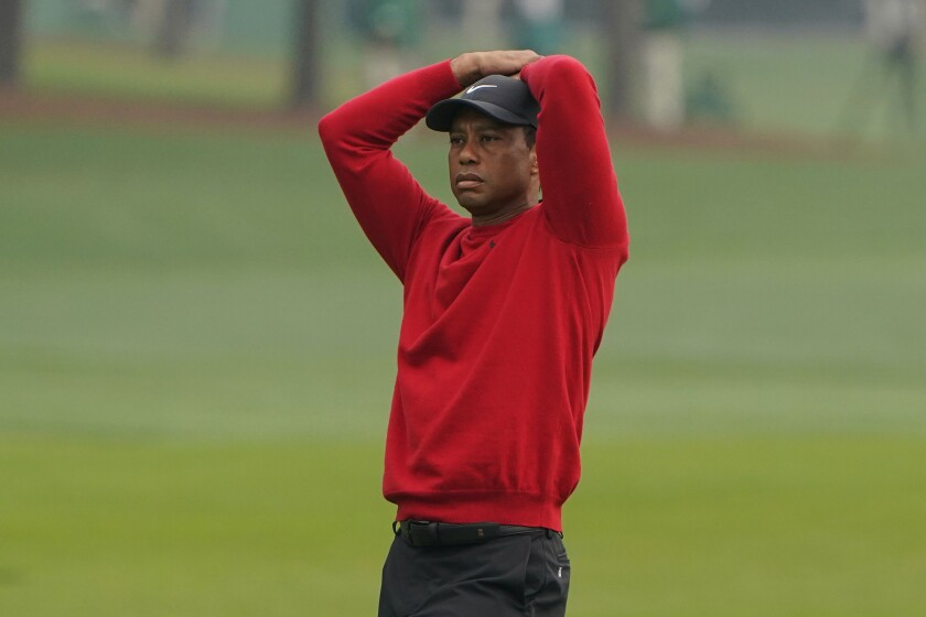 Tiger Woods reacts during the final round of the Masters golf tournament in November.