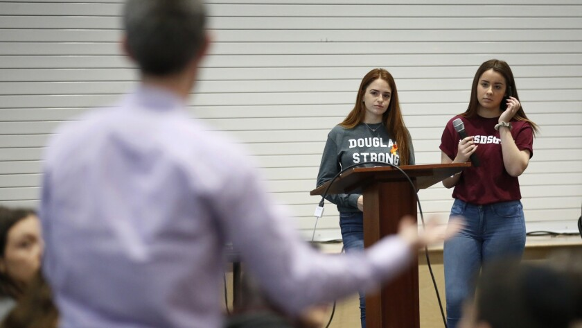 """Marjory Stoneman Douglas High School students Hayley Licata, left, and Mia Freeman speak to students at Shalhevet High School in Los Angeles for a """"Safe Schools""""€ public discussion."""