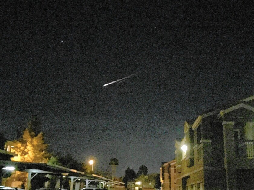 Debris from a Russian rocket reentering the atmosphere streaks through the night sky above Las Vegas on Tuesday.