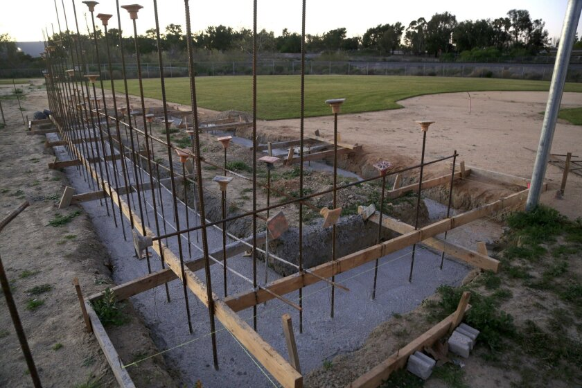 A dugout remains under construction at one of the ballfields that make up French Field, home of the Vista American Little League. The fields were closed for 11 years for cleanup at the site, which sits atop a former landfill. The cleanup is finally complete and the fields are back in place. The lea