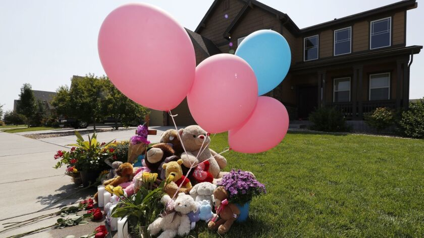 A makeshift memorial outside the Watts family home in Frederick, Colo.