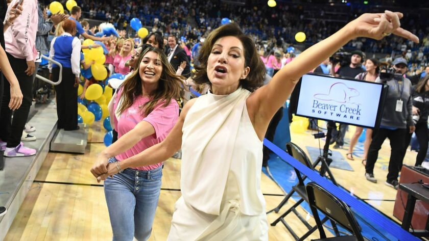 LOS ANGELES, CALIFORNIA MARCH 23, 2019-UCLA head gymnastics coach Valorie Kondos Field leads former