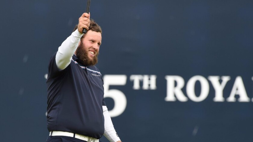 Andrew Johnston takes off his hat and salutes the crowd during his final round of the British Open on Sunday.