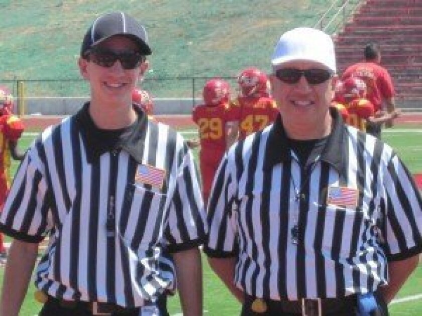 Vincent and Sal Gambino refereed a local football game together.