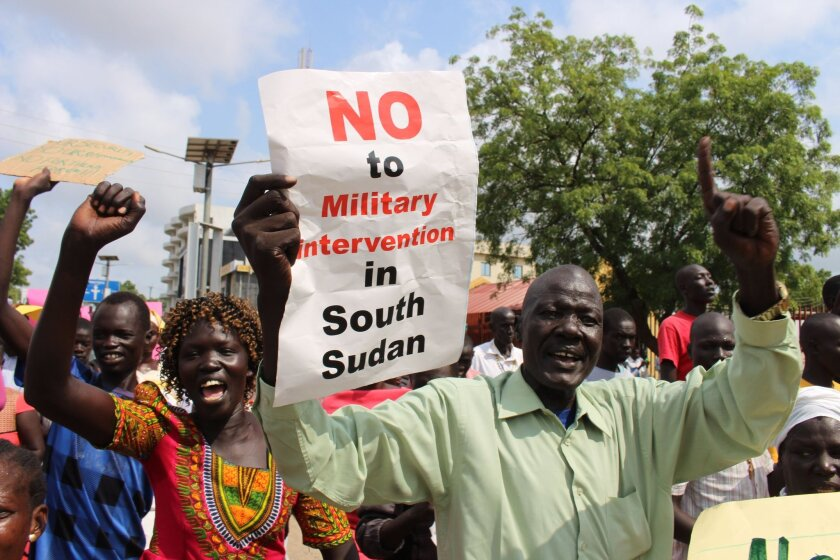 Hundreds of South Sudanese protest in Juba, South Sudan against Foreign military intervention Wednesday July 20, 2016. Hundreds of people from civil society and political parties protested in Juba. This week African leaders have backed plans to deploy regional troops to South Sudan after recent fighting between rival forces left hundreds of people dead . (AP Photo/Samir Bol)