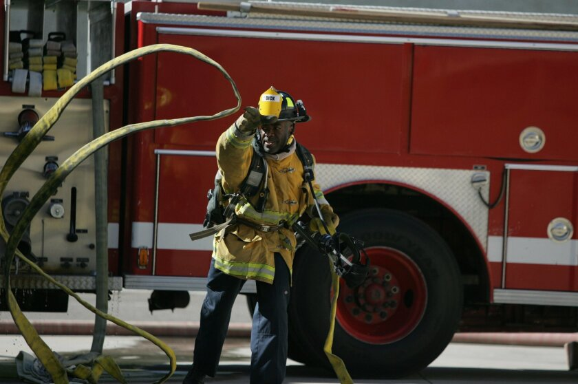 Roderick Dick unraveled a hose during a training exercise. The recruits earn $2,800 a month during the academy.