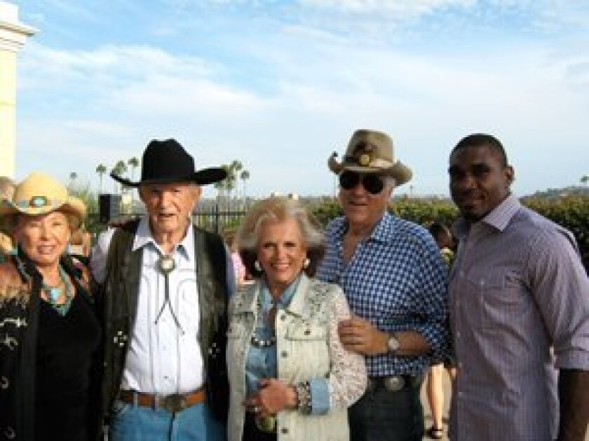Friends of San Pasqual Academy members Bill and Donna Herrick, 2012 Teens, Jeans and Dreams Chairpersons Bill and Connie Mc Nally and Honorary Chairperson Charger Quentin Jammer.  Proceeds for Teens, Jeans and Dreams benefit the 150 foster teens of San Pasqual Academy.