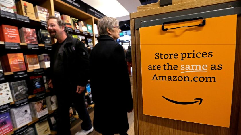 Customers shop at the opening day for Amazon Books, the first brick-and-mortar retail store for onli