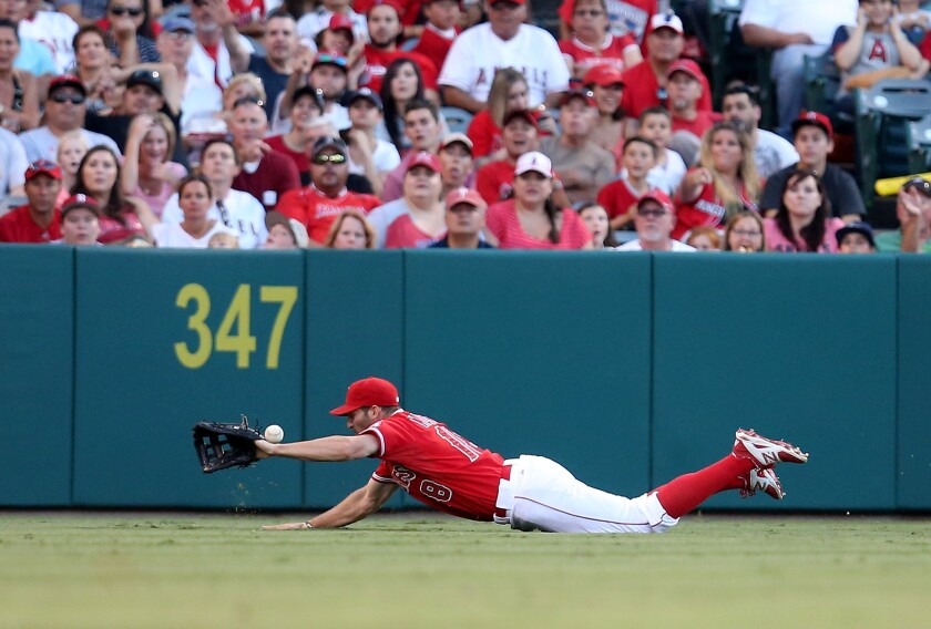 Former Angels left fielder Kyle Kubitza dives for a fly ball against the Rangers in Anaheim on July 25, 2015.