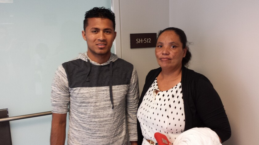 Elman Soriano, left, and Dilsia Acosta visited Capitol Hill on Thursday to plead for release of their relatives who were swept up in immigration raids this year.