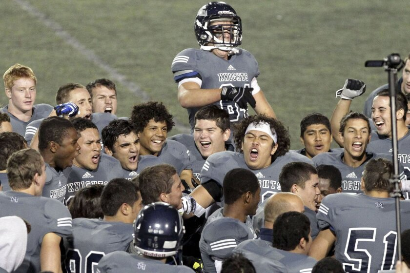 San Marcos players celebrate after they beat Granite Hills in the Division III semifinals on Friday.