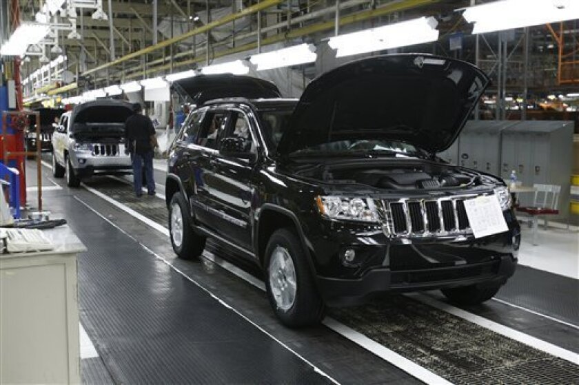 FILE - In this May 21, 2010 file photo, the 2011 Jeep Grand Cherokee rolls off the assembly line at the Chrysler Jefferson North Assembly Plant in Detroit. New models and Labor Day promotions didn't do much to fire Americans' appetites for new cars in September. Still, auto executives expect a modest recovery for the remainder of the year. (AP Photo/Carlos Osorio, file)