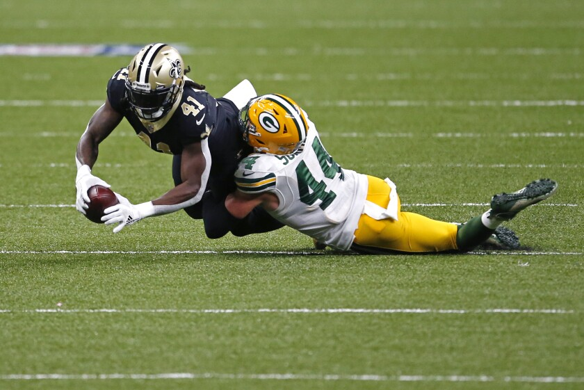 New Orleans Saints running back Alvin Kamara (41) is tackled by Green Bay Packers linebacker Ty Summers (44) in the first half of an NFL football game in New Orleans, Sunday, Sept. 27, 2020. (AP Photo/Butch Dill)