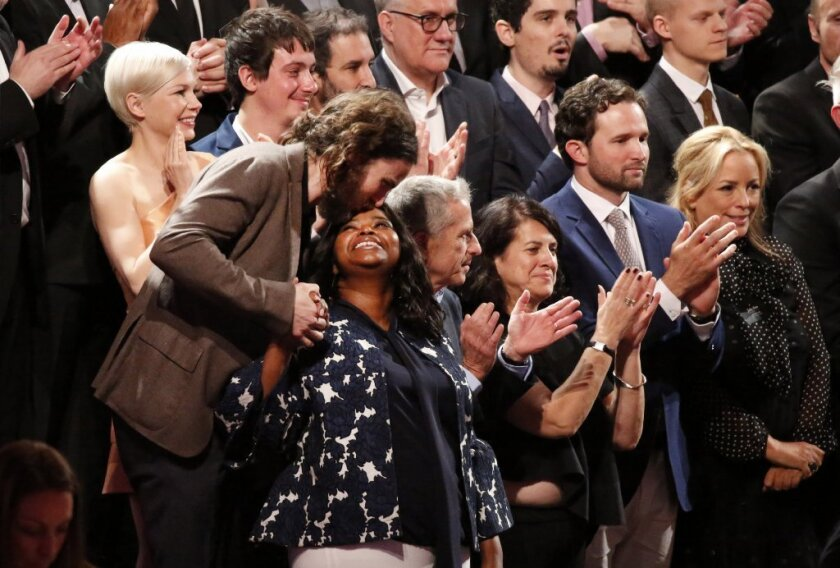 Casey Affleck kisses Octavia Spencer on the platform Monday as they prepare for the class picture of all the nominees during the Academy Awards annual nominees luncheon for the 89th Oscars at the Beverly Hilton Hotel in Beverly Hills.