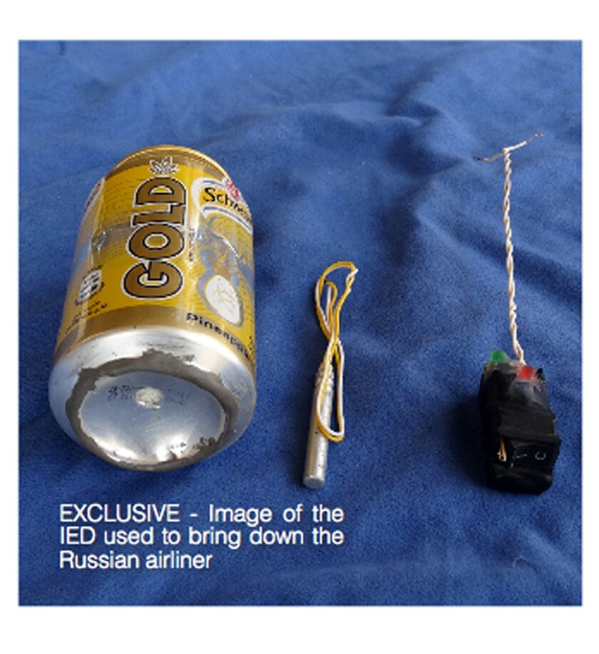 This undated image made available in the Islamic State's English-language magazine Dabiq, Wednesday, Nov. 18, 2015, claims to show the bomb that was used to blow up a Metrojet passenger plane bound for St. Petersburg, Russia, that crashed in Hassana, north Sinai, Egypt, killing all 224 people on board. (Militant photo via AP)