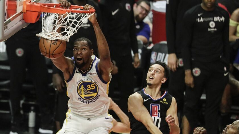 LOS ANGELES, CA, SUNDAY, APRIL 21, 2019 - Warriors forward Kevin Durant slams home two points late i