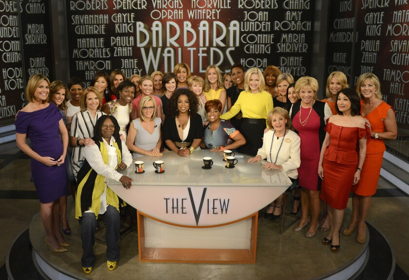 """On May 15, her final day as cohost of """"The View,"""" Barbara Walters, seated right, was saluted by Oprah Winfrey, center, her fellow hosts and two dozen female broadcasters."""