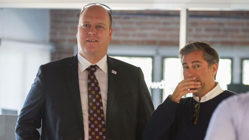 enise Gitsham announced that she will run against 52nd district incumbent congressman Scott Peters running as a Republican at an event in Little Italy on Thursday, November 5. Local republican bigwig Tony Krvaric, left, and Gitsham's campaign manager Jaso
