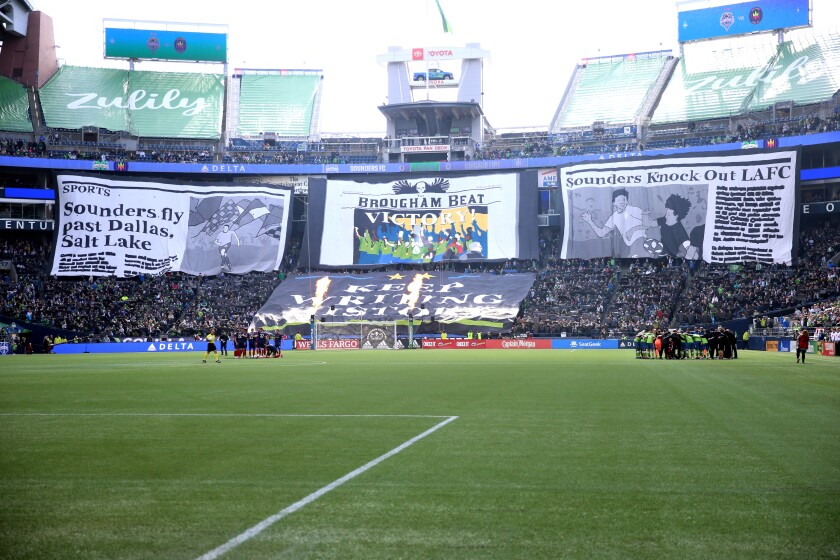 Seattle Sounders fans display banners celebrating the team's 2019 MLS Cup championship before a game against the Chicago Fire on March 1 at CenturyLink Field.