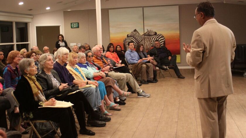 The La Jolla Community Center draws a crowd for Aboo Nasar's talk on happiness, Feb. 16.