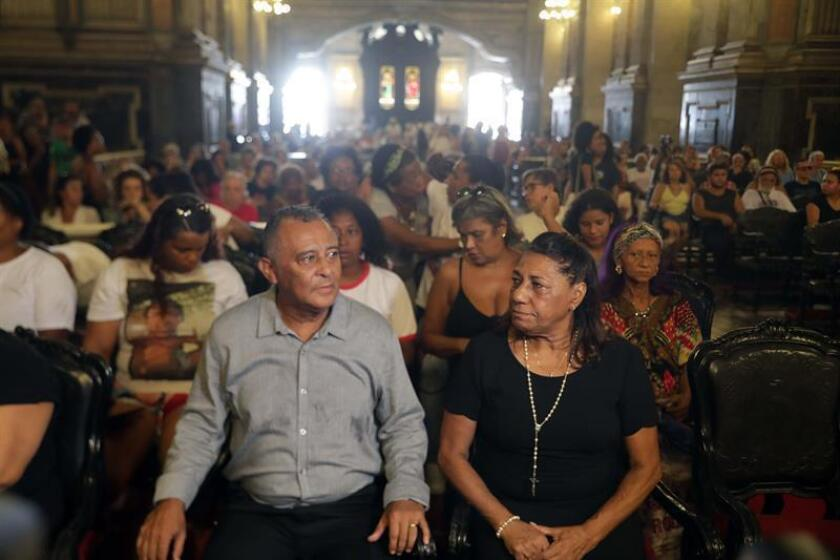 Marinete Francisco and Antonio da Silva, the parents of late rights activist and Rio de Janeiro city councilor Marielle Franco, attend a Mass on March 14, 2019, in Rio de Janeiro, Brazil, on the one-year anniversary of the politician's death in a drive-by shooting. EPA-EFE/Antonio Lacerda