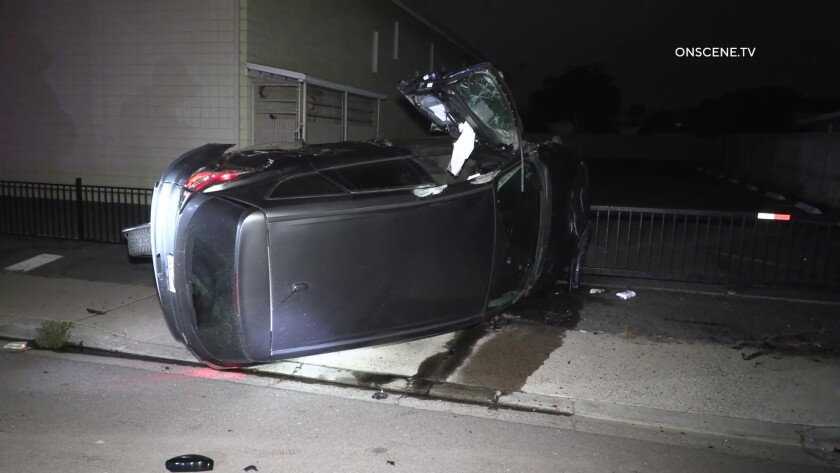 An SUV on its side