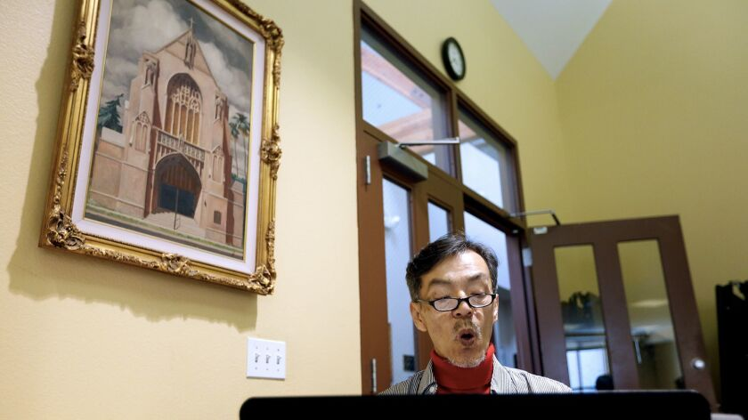 Seon Jin Kim participates in choir practice at St. James Episcopal Church in Los Angeles.