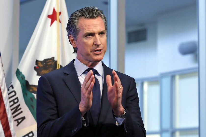 """FILE - In this April 14, 2020, file photo, California Gov. Gavin Newsom discusses an outline for what it will take to lift coronavirus restrictions during a news conference at the Governor's Office of Emergency Services in Rancho Cordova, While California will end most coronavirus rules on June 15, Gov. Gavin Newsom said Friday, June 4, 2021 he will not lift the """"state of emergency"""" that has been in place since March 2020. (AP Photo/Rich Pedroncelli, Pool, File)"""