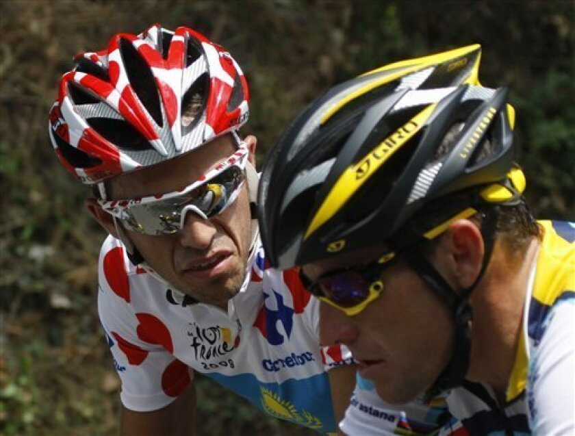 American seven-time Tour de France winner Lance Armstrong, right, and his teammate Alberto Contador of Spain, left, wearing the best climber's dotted jersey, are seen talking during the second stage of the Tour de France cycling race over 187 kilometers (116 miles) with start in Monaco and finish in Brignolles, southern France, Sunday July 5, 2009. (AP Photo/Christophe Ena)