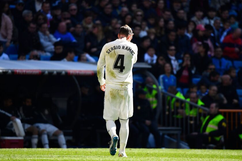 Real Madrid's Spanish defender Sergio Ramos walks off the pitch after receiving a red card during the Spanish League football match between Real Madrid and Girona at the Santiago Bernabeu stadium in Madrid on February 17, 2019.