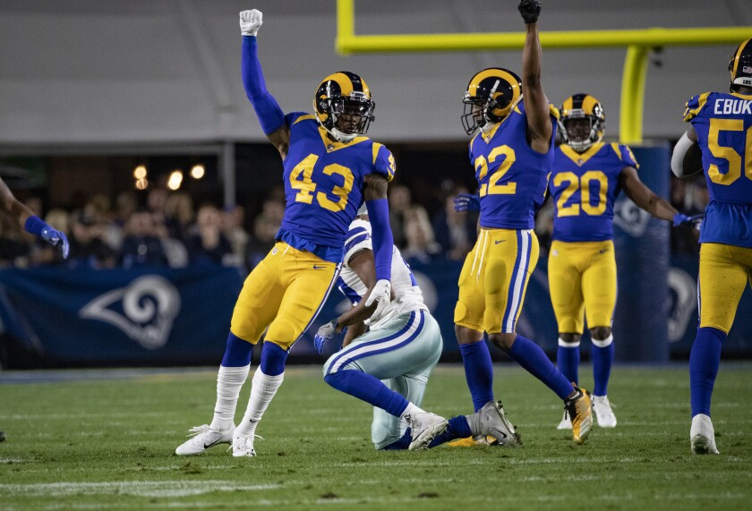 Rams strong safety John Johnson (43) and cornerback Marcus Peters (22) react after a defensive stop on the Dallas Cowboys on Saturday at the Coliseum.