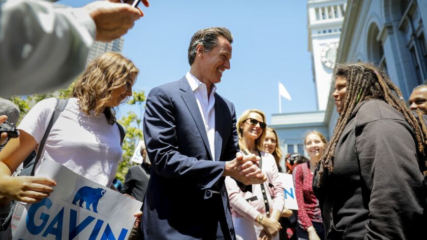 Lt. Gov. Gavin Newsom, center, talks to supporters in San Francisco on June 6, the morning after advancing to the general election in his campaign for California governor.