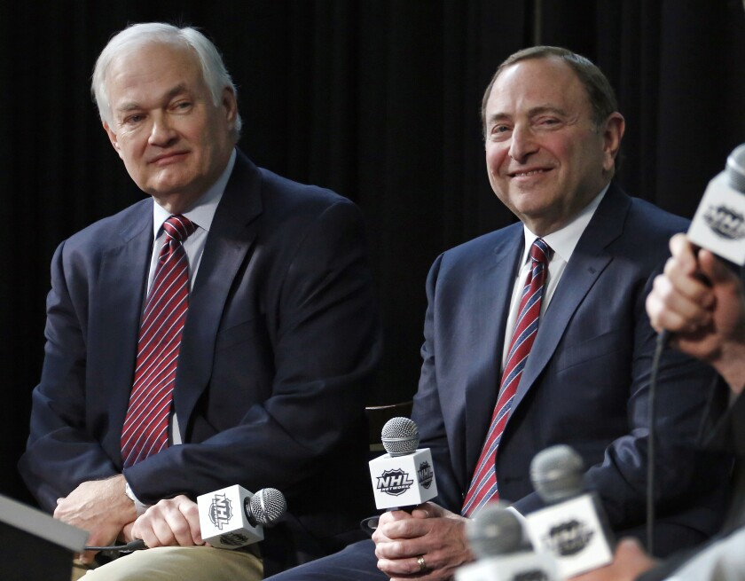 NHLPA Executive Director Donald Fehr, left, and NHL Commissioner Gary Bettman at a news conference Jan. 24, 2015.