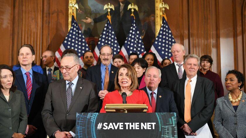 House Speaker Nancy Pelosi, alongside Senate Minority Leader Chuck Schumer (second from left), announces net neutrality legislation at the Capitol on March 6.