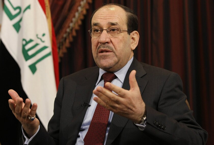 File -- In this Saturday, Dec. 3, 2011 file photo, Iraq's Shiite Prime Minister Nouri al-Maliki is seen during an interview with The Associated Press in Baghdad, Iraq. In results announced Monday, May 19, 2014, State of Law, a coalition led by Al-Maliki has emerged as the biggest winner in the coun