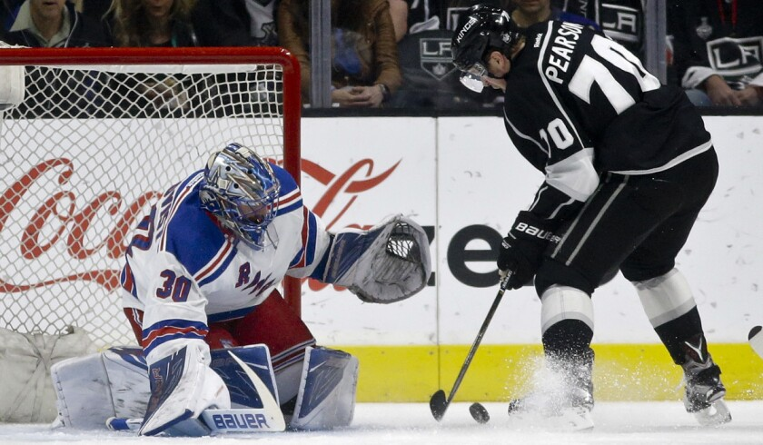 New York Rangers goalie Henrik Lundqvist, left, blocks a shot by Los Angeles Kings left wing Tanner Pearson during the first period on Thursday.