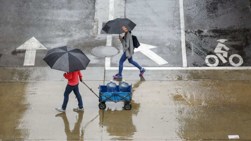 Pedestrians at USC during a March 22 storm in Los Angeles.