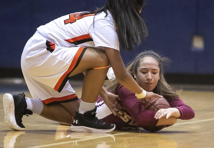 Los Amigos girls' basketball beats Estancia to extend winning streak to five