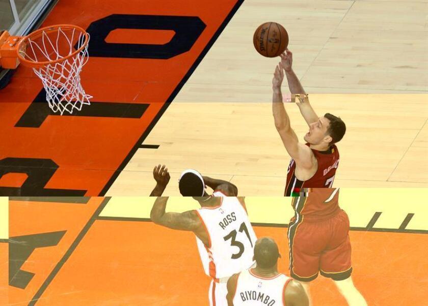 Dragic (d) anotó 13 puntos en el cuarto periodo del partido con el que los Heat han comenzado una serie de seis que van a disputar en su campo del American Airlines Arena de Miami. EFE/Archivo