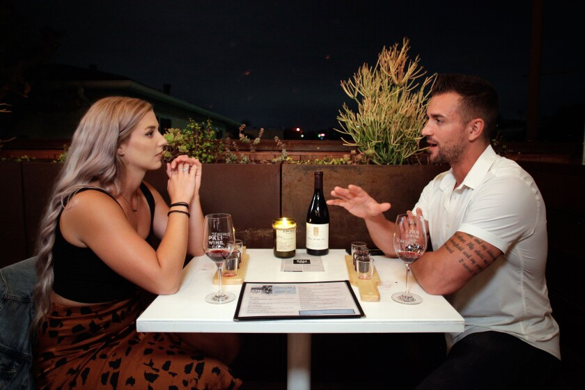 A photo of Austin (left) and Vince chatting while on a blind date at Pali Wine Co. in downtown.