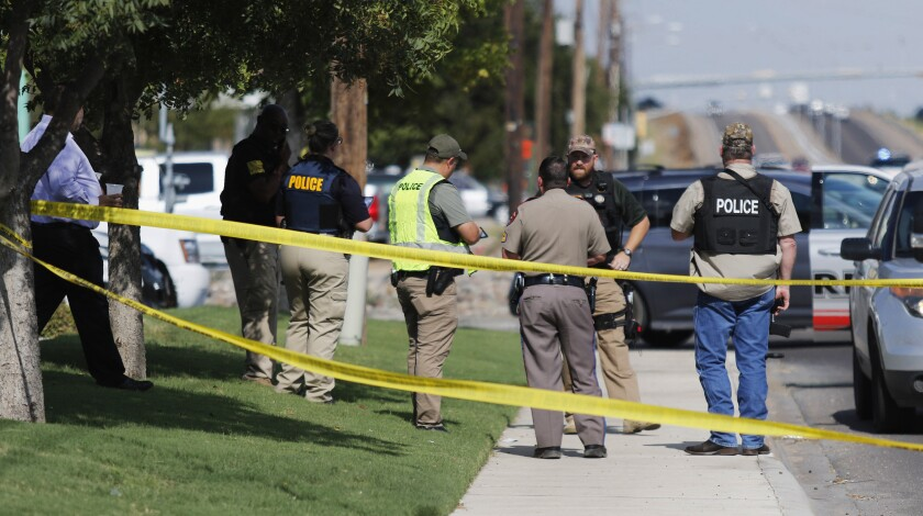 Authorities cordon off a portion of 42nd Street in Odessa, Texas, where some of the shootings occurred.