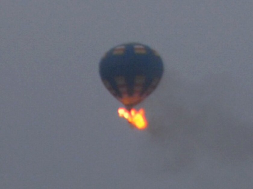 A hot-air balloon erupts into flames before crashing in Virginia. The pilot and a passenger were confirmed dead, and a third person is missing.